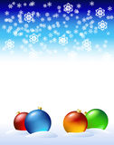 Christmas balls are on the snow. New Year's decorations in the snow are shown in the image Royalty Free Stock Photos