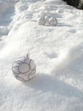 Christmas balls on snow Stock Images