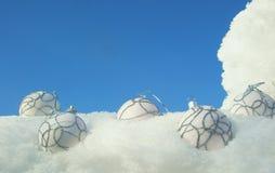 Christmas balls on snow Stock Images