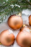 Christmas balls on the snow. Christmas gold balls and snow Royalty Free Stock Image