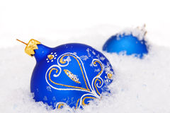 Christmas balls with snow Stock Photos