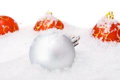 Christmas balls with snow Stock Image