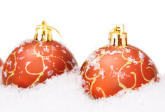 Christmas balls with snow Royalty Free Stock Photos