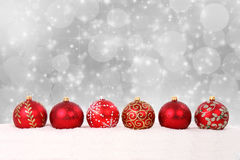 Christmas balls and snow on abstract background Royalty Free Stock Photo