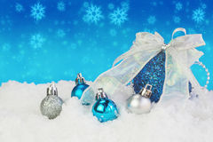 Christmas balls with snow on abstract background Royalty Free Stock Images