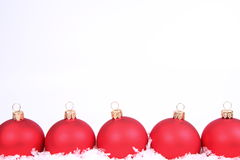 Christmas balls and snow background Stock Photo