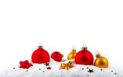 Christmas balls on the snow Royalty Free Stock Photos