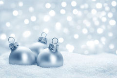 Christmas balls on snow. Blue christmas balls on snow close up Royalty Free Stock Image