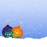 Christmas balls on the snow. Blue and orange balls on the snow Stock Photo