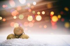 Christmas balls and snow on bokeh background Stock Photos