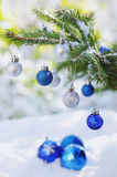 Christmas balls on the snow and branch of Christmas tree outdoor Stock Photo