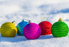 Christmas balls on a snow Stock Images