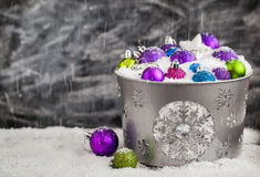 Christmas balls in snow covered bucket Stock Image