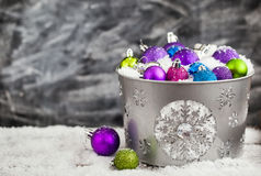 Christmas balls in snow covered bucket Royalty Free Stock Photo