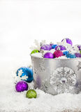 Christmas balls in snow covered bucket Royalty Free Stock Images