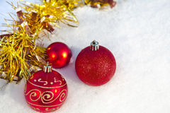 Christmas balls on snow Royalty Free Stock Photos