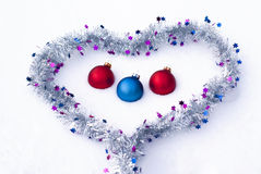 Balls in the heart on the snow Royalty Free Stock Image