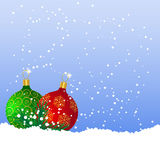 Christmas balls on the snow. Green and red Christmas balls on the snow Royalty Free Stock Image