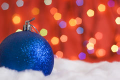 Christmas balls in snow and lights.  Stock Photography