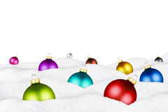 Christmas balls in snow Stock Images