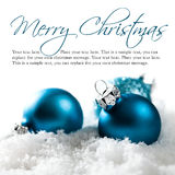 Christmas balls in the snow with merry christmas greeting and sample text Stock Photos
