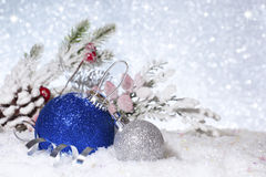 Christmas balls in the snow. New Year composition. stock image
