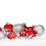 Christmas balls on snow Stock Photos