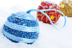 Christmas balls on the snow Stock Images