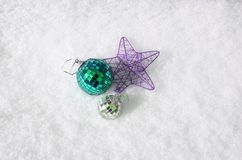 Christmas balls on the snow, top view. royalty free stock image
