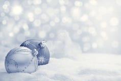 Christmas balls on snow Stock Image