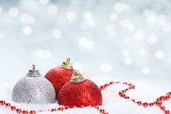 Christmas balls on snow Royalty Free Stock Photos