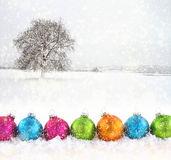 Christmas balls with snowfield Stock Photo