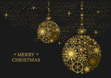 Christmas balls with snowflakes on a black background. Golden christmas balls with snowflakes on a black background. Holiday card Stock Image
