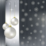 Christmas balls and snowflakes on a silver Royalty Free Stock Photo