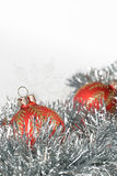 Christmas balls and snowflakes on tinsel Royalty Free Stock Photo