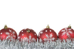 Christmas balls with snowflakes on tinsel Stock Photography