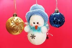 Christmas balls and snowman. Royalty Free Stock Image
