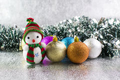Christmas balls and snowman on a silver background Royalty Free Stock Image