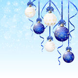 Christmas balls on snowy background Stock Photography