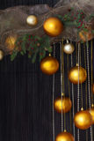 Christmas Balls and Spruce Branches with Cones on Natural Backgr Royalty Free Stock Photography