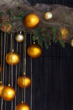 Christmas Balls and Spruce Branches with Cones on Natural Backgr Royalty Free Stock Image