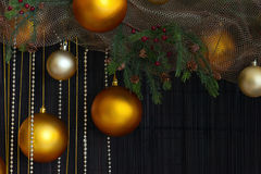 Christmas Balls and Spruce Branches with Cones on Natural Backgr Royalty Free Stock Images