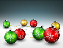 Christmas balls and star confetti on the floor background Stock Photos