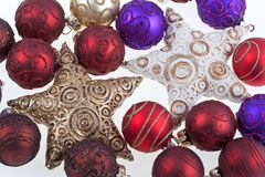 Christmas balls and stars. Colorful Christmas balls on white with stars Stock Image