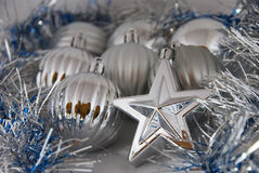 Christmas balls and stars. Silver Christmas balls and stars decorations - background Stock Photos