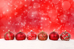 Christmas balls and stars on abstract background Stock Photos