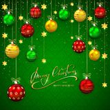 Christmas balls and stars on green backgroundGreen background wi Stock Photo