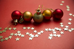 Christmas balls and stars on red background Stock Photography