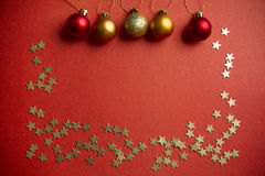 Christmas balls and stars on a red background. Christmas balls and stars to decorate on a red background. New year Royalty Free Stock Photography