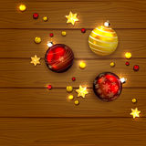 Christmas balls and stars on wooden background Stock Image